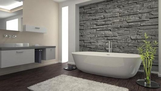 Azulejos imitacion piedra en un baño